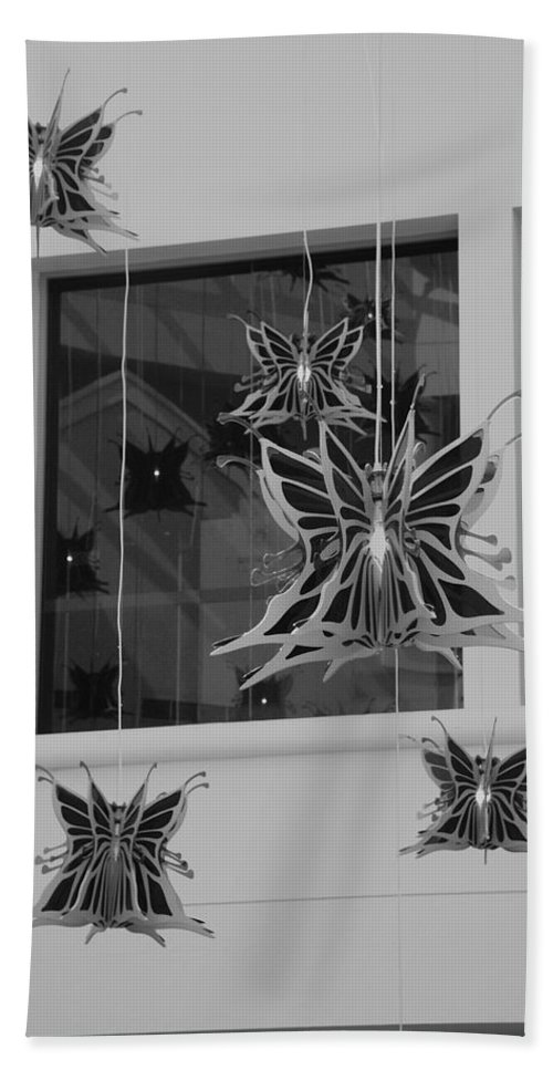 Black And White Bath Towel featuring the photograph Hanging Butterflies by Rob Hans
