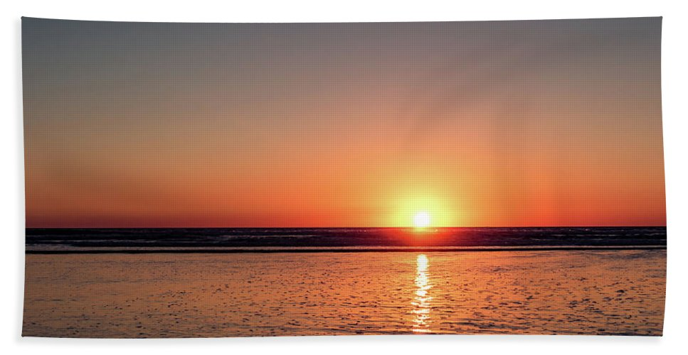 Sunset Hand Towel featuring the photograph Sunset Over The Ocean by Eric Strickland