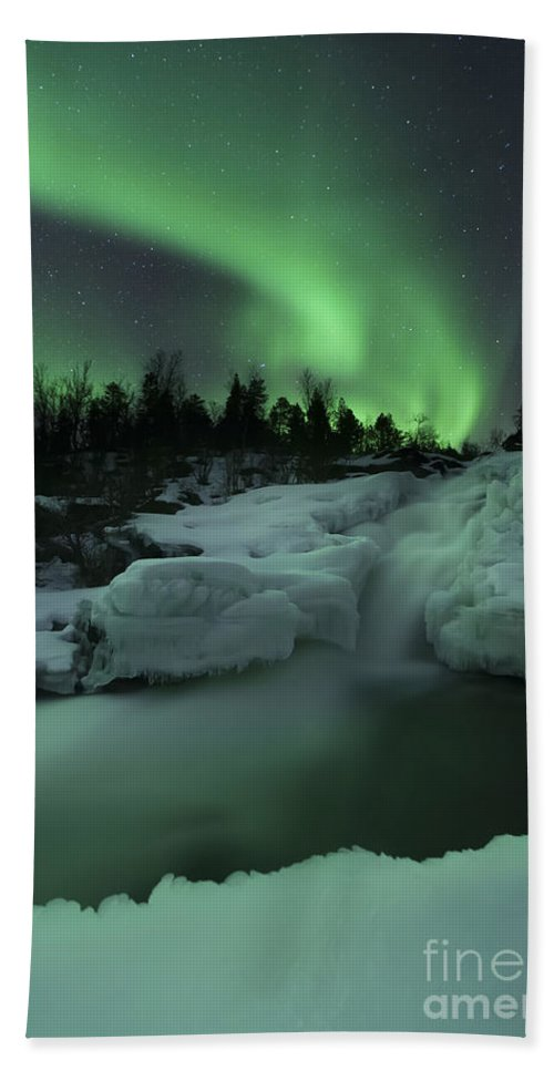 Green Bath Towel featuring the photograph A Wintery Waterfall And Aurora Borealis by Arild Heitmann
