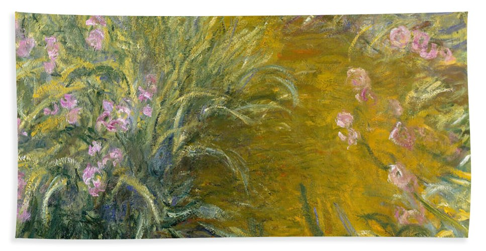 Claude Monet Hand Towel featuring the painting The Path Through The Irises by Claude Monet