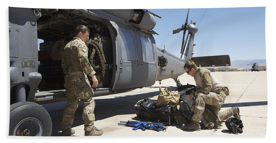 Exercise Angel Thunder Bath Sheet featuring the photograph Pararescuemen Sorts Out His Gear by Terry Moore