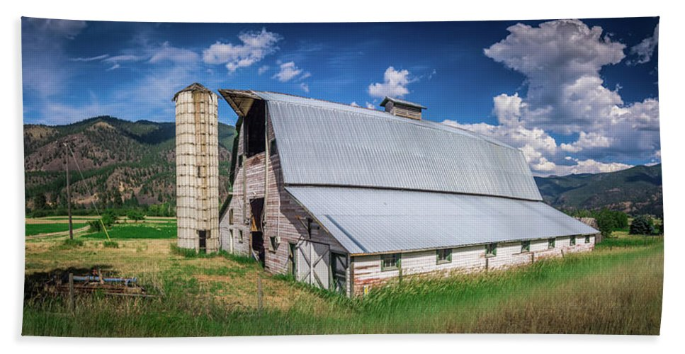 Summer Bath Sheet featuring the photograph Summer Sunset With A Red Barn In Rural Montana And Rocky Mountai by Alex Grichenko