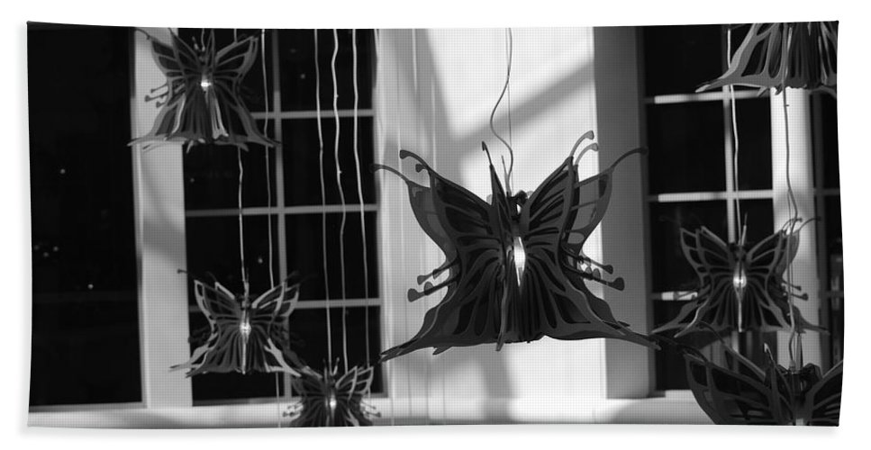Black And White Bath Sheet featuring the photograph Hanging Butterflies by Rob Hans