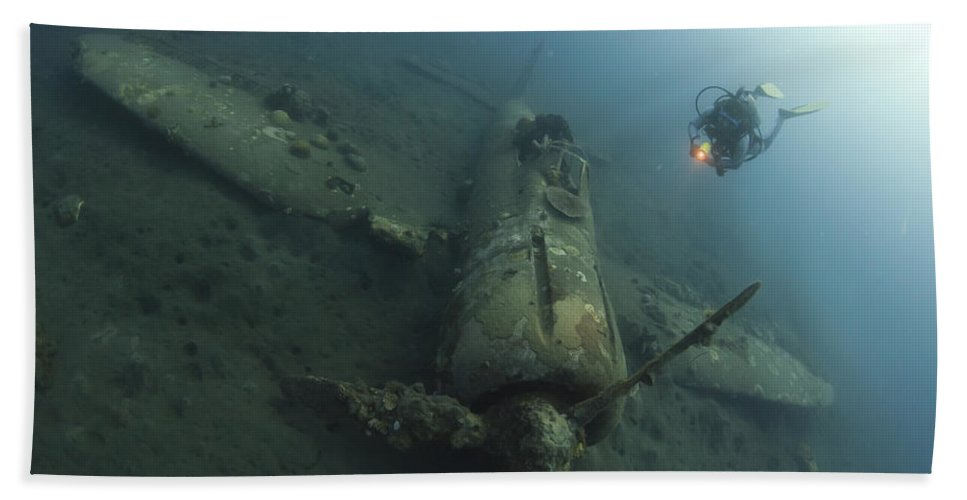 Kimbe Bay Bath Sheet featuring the photograph Diver Explores The Wreck by Steve Jones