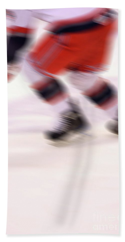 Hockey Bath Sheet featuring the photograph A Blur Of Ice Speed by Karol Livote