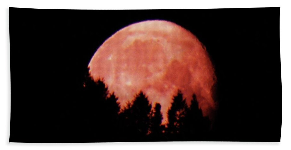 Full Moon Hand Towel featuring the photograph A Full Moon Sinking Behind The Mountains by Jeff Swan