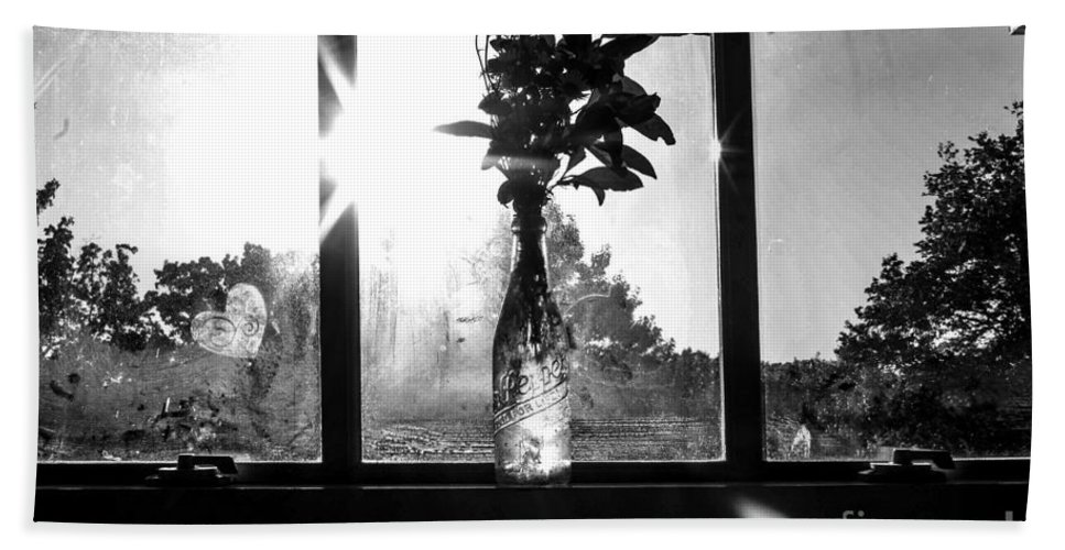 Glass Bath Sheet featuring the photograph A Glass Bottle On A Windowsill by Taylor McLaurin