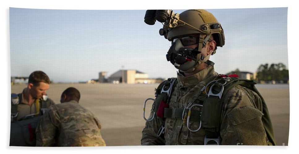 Soldier Bath Sheet featuring the photograph A Green Beret Waits To Have His Gear by Stocktrek Images