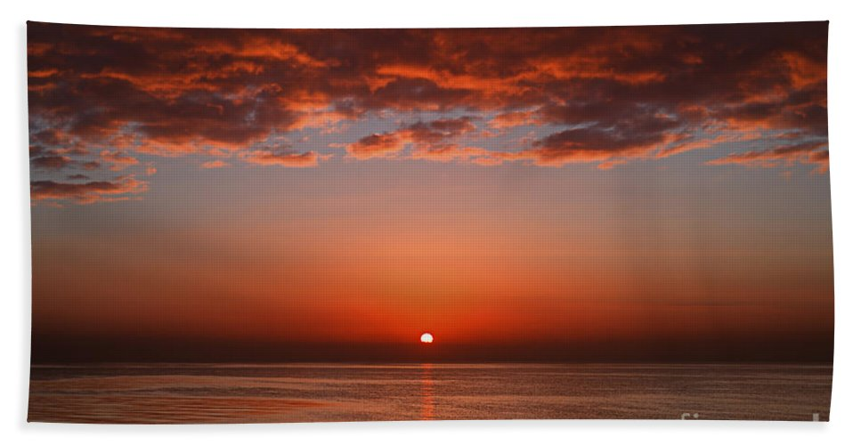 Scenic Bath Sheet featuring the photograph A Layer Of Clouds Is Lit By The Rising by Luis Argerich
