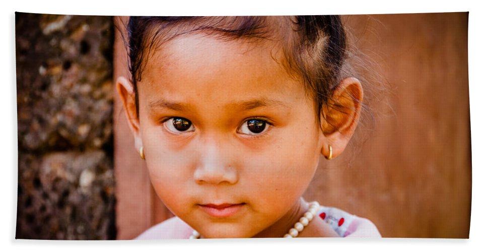 Girl Bath Sheet featuring the photograph A Little Khmer Beauty by Volodymyr Dvornyk