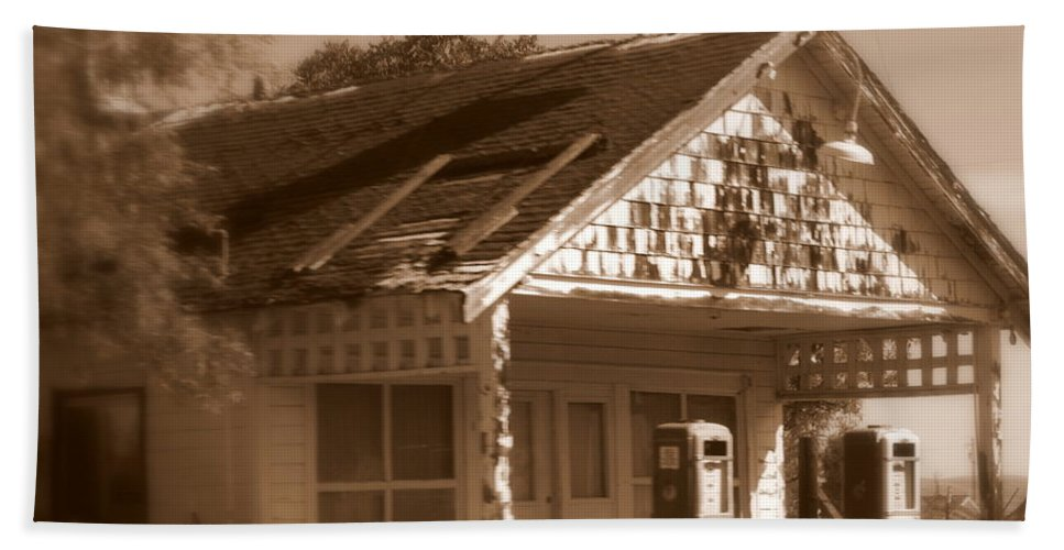 Old Building Hand Towel featuring the photograph A Little Weathered Gas Station by Carol Groenen