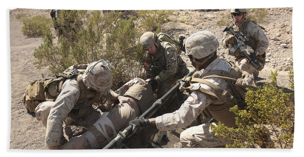 Combat Bath Sheet featuring the photograph A Medic Treats Injuries On A Downed by Stocktrek Images