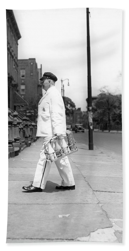 1 Person Hand Towel featuring the photograph A Milkman Delivering Milk by Underwood Archives