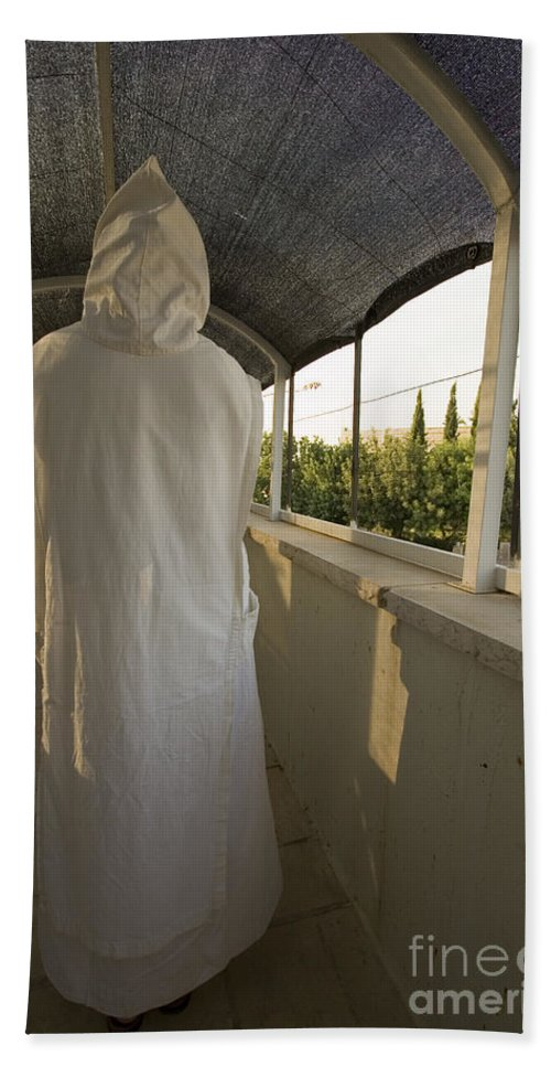 Nun Bath Towel featuring the photograph A Nun In A Monastery by Danny Yanai
