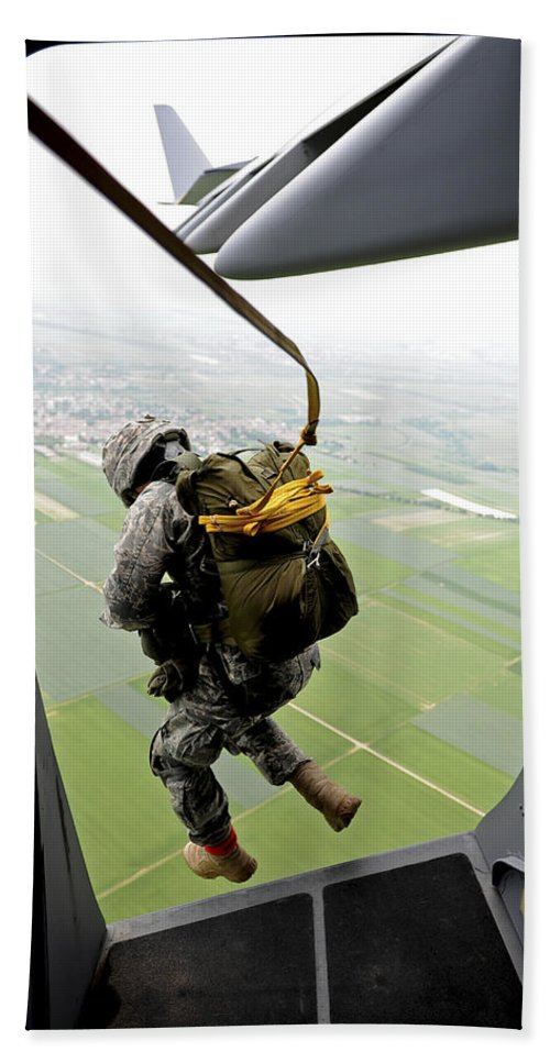 C-17 Globemaster Bath Sheet featuring the photograph A Paratrooper Executes An Airborne Jump by Stocktrek Images