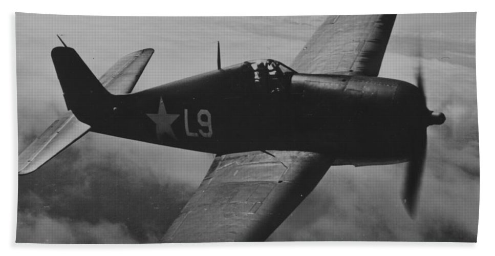 Plane Bath Sheet featuring the photograph A Us Navy Hellcat Fighter Aircraft In Flight by American School