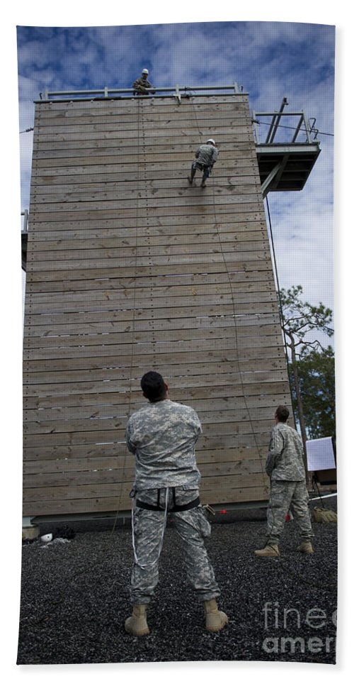 Soldier Bath Sheet featuring the photograph A U.s. Soldier Rappels Down A 40-foot by Stocktrek Images
