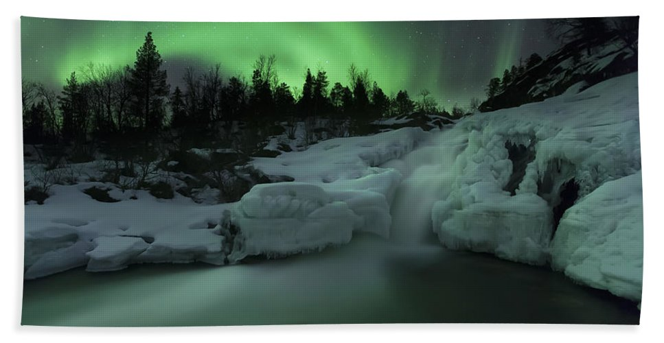 Green Hand Towel featuring the photograph A Wintery Waterfall And Aurora Borealis by Arild Heitmann