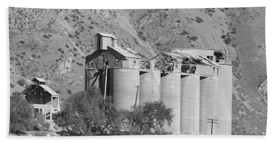 Abandoned Hand Towel featuring the photograph Abandoned Silos by Pat Turner