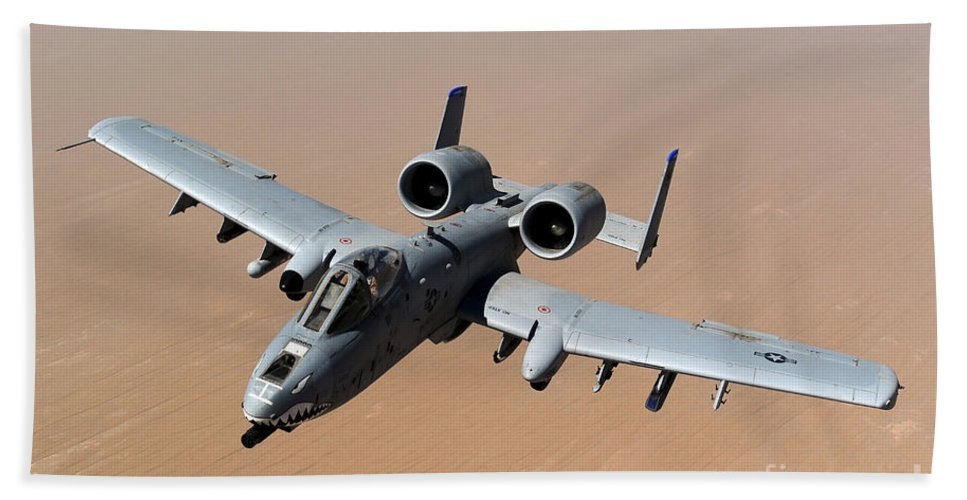 A-10 Hand Towel featuring the photograph An A-10 Thunderbolt II Over The Skies by Stocktrek Images