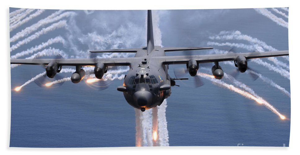 Ac-130 Hand Towel featuring the photograph An Ac-130h Gunship Aircraft Jettisons by Stocktrek Images
