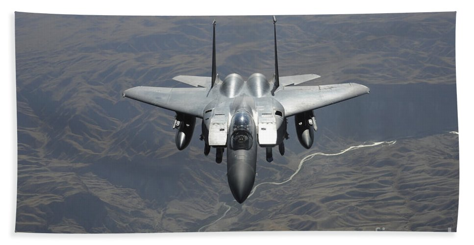 F-15 Hand Towel featuring the photograph An F-15e Strike Eagle Flies Watch by Stocktrek Images