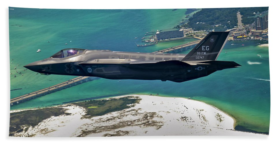 Stealth Bath Sheet featuring the photograph An F-35 Lightning II Flies Over Destin by Stocktrek Images