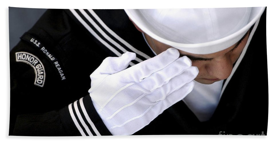 Color Image Hand Towel featuring the photograph An Honor Guard Member Renders A Salute by Stocktrek Images