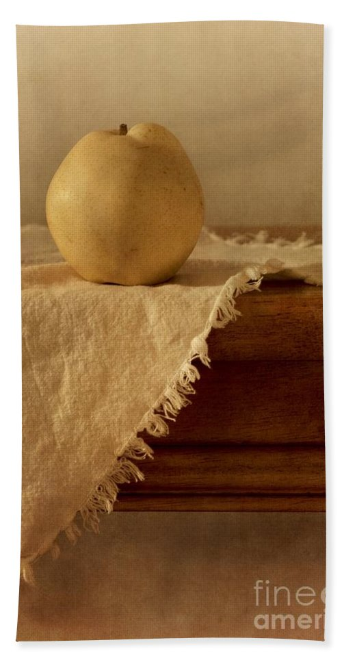 Dining Room Hand Towel featuring the photograph Apple Pear On A Table by Priska Wettstein