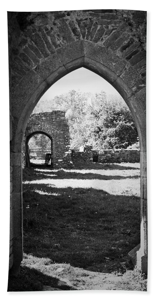 Irish Bath Towel featuring the photograph Arched Door At Ballybeg Priory In Buttevant Ireland by Teresa Mucha