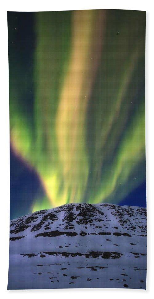 Aurora Borealis Bath Towel featuring the photograph Aurora Borealis Over Toviktinden by Arild Heitmann