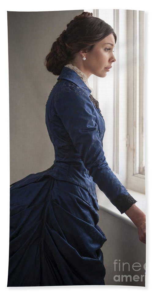 Victorian Hand Towel featuring the photograph Beautiful Victorian Woman At The Window In A Blue Bussle Dress by Lee Avison