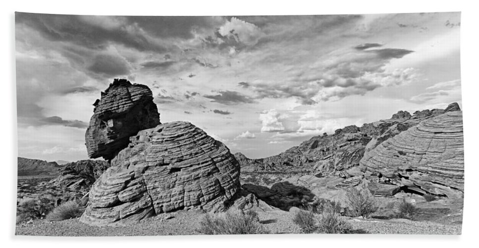 Beehive Bath Towel featuring the photograph Beehive rock formation under a stormy sky. by Jamie Pham