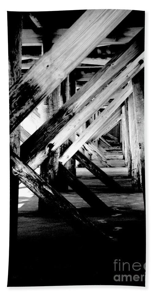 Black Hand Towel featuring the photograph Beneath The Docks Night by Jamie Lynn