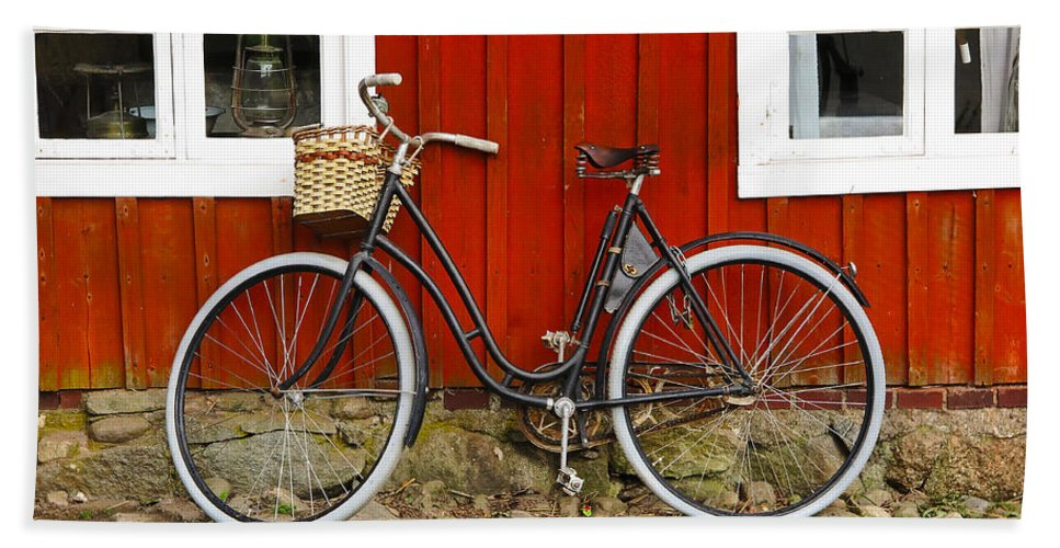Bicycle Bath Sheet featuring the photograph Bicycle In Front Of Red House In Sweden by Greg Matchick