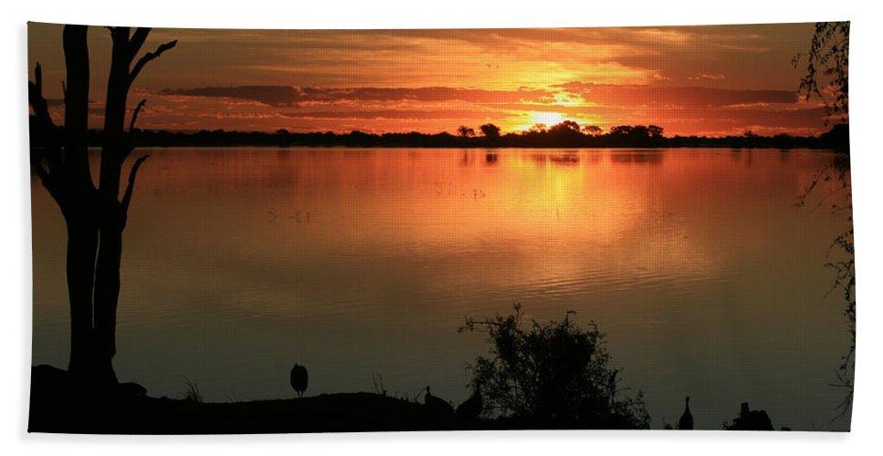 Karen Zuk Rosenblatt Art And Photography Bath Sheet featuring the photograph Botswanna Sunset by Karen Zuk Rosenblatt