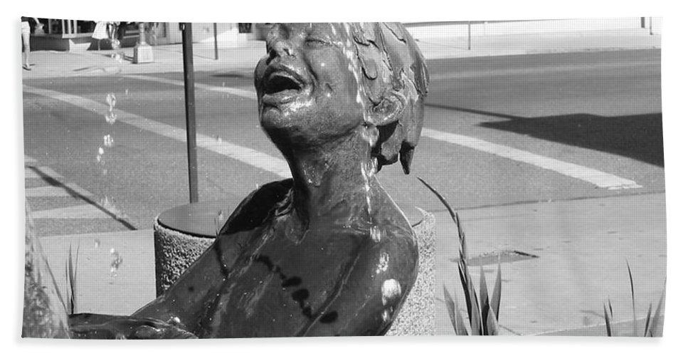 Boy In Fountain Sculture Hand Towel featuring the photograph Boy In Fountain Sculture Grand Junction Co by Tommy Anderson