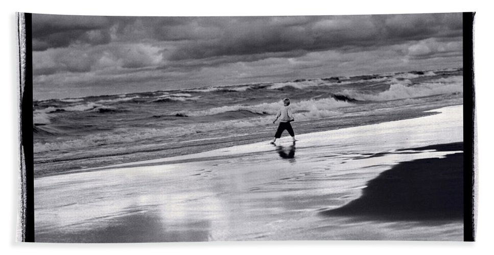 Beach Hand Towel featuring the photograph Boy On Shoreline by Steve Gadomski