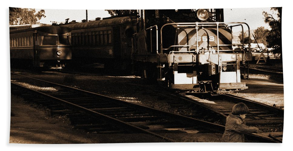 Train Hand Towel featuring the photograph Boy On The Tracks by Anthony Jones