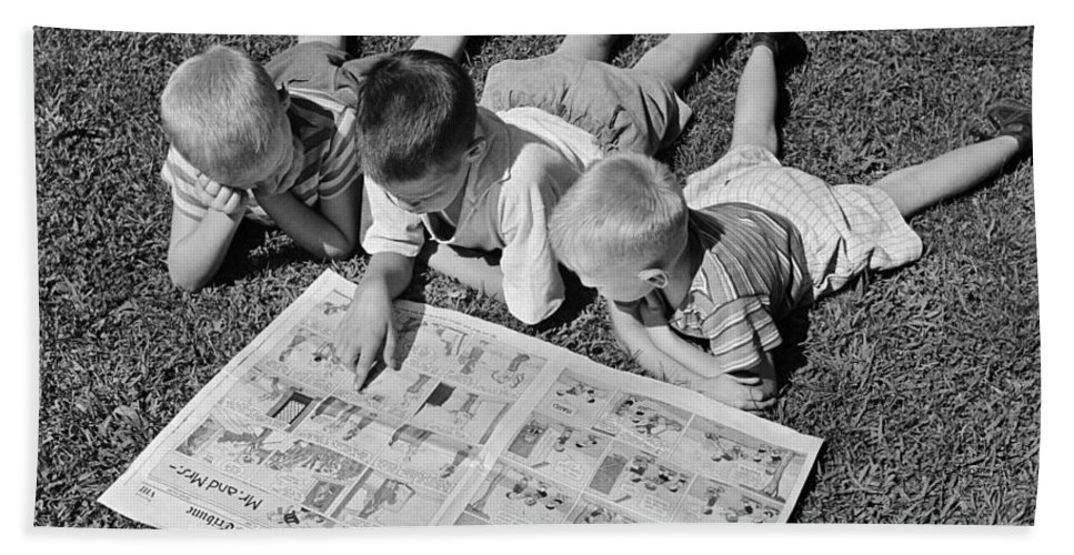 1950s Bath Sheet featuring the photograph Boys Reading Newspaper Comics, C.1950s by G. Hampfler/ClassicStock