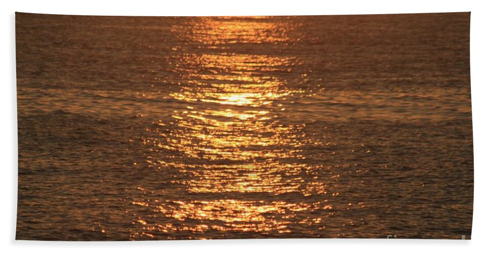 Ocean Hand Towel featuring the photograph Bronze Reflections by Nadine Rippelmeyer