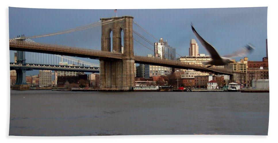 Brooklyn Bridge Bath Sheet featuring the photograph Brooklyn Bridge And Bird In Flight by Anita Burgermeister