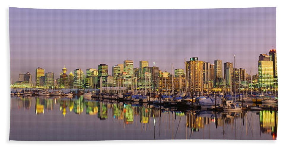 Photography Bath Sheet featuring the photograph Buildings Lit Up At Dusk, Vancouver by Panoramic Images