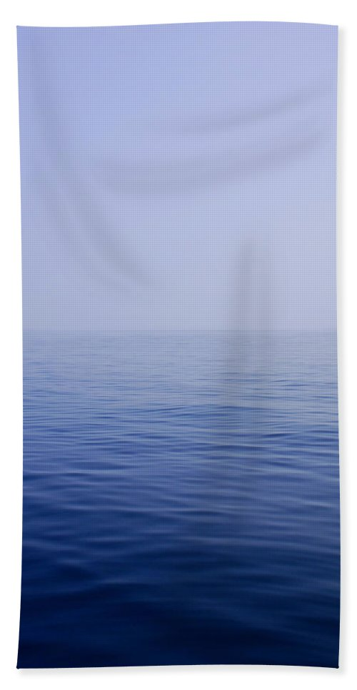 Calm Hand Towel featuring the photograph Calm Sea by Charles Harden