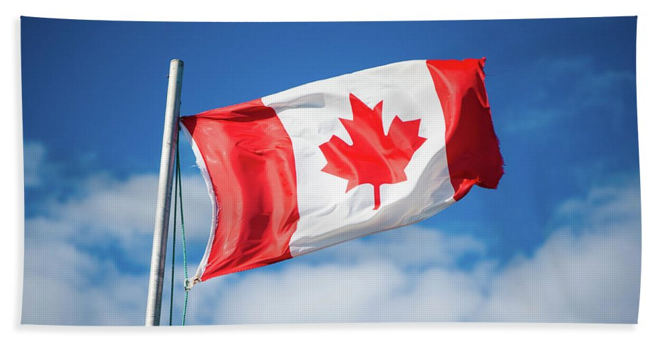 Canada Bath Sheet featuring the photograph Canadian Flag Flying Proudly by Selinda Van Horn