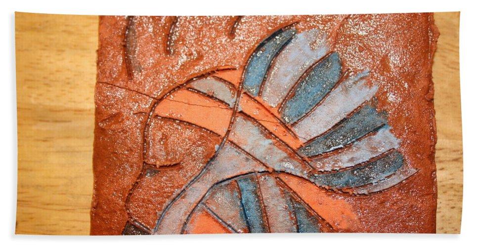 Jesus Hand Towel featuring the ceramic art Celia - Tile by Gloria Ssali