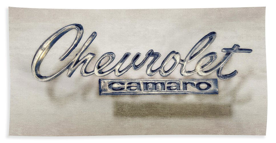Automotive Hand Towel featuring the photograph Chevrolet Camaro Badge by YoPedro