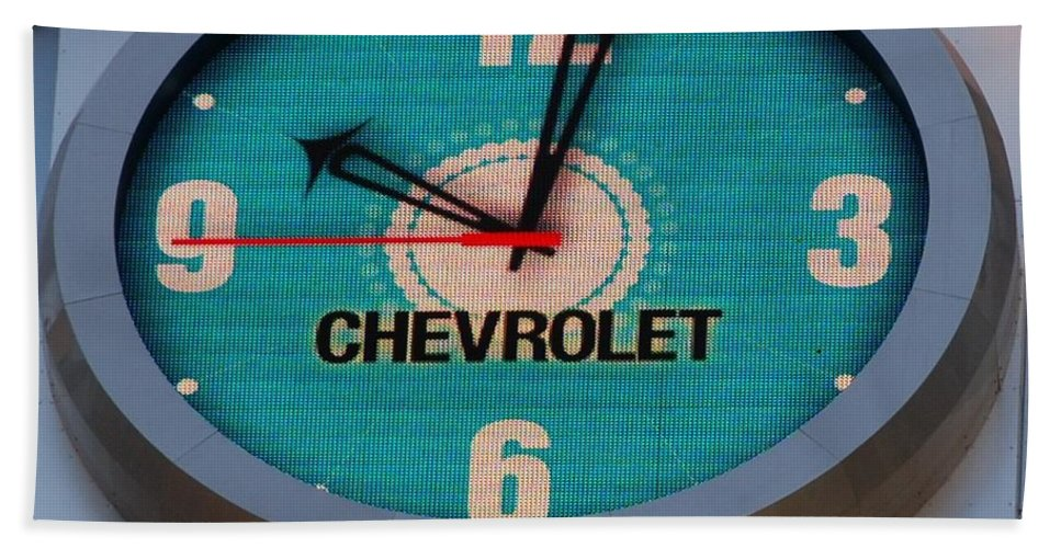 Clock Bath Towel featuring the photograph Chevy Neon Clock by Rob Hans