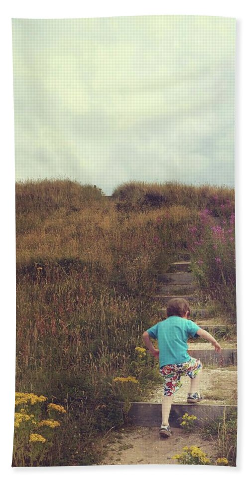 Beach Bath Sheet featuring the photograph Child On Stairs On Beach by Lenore Humes