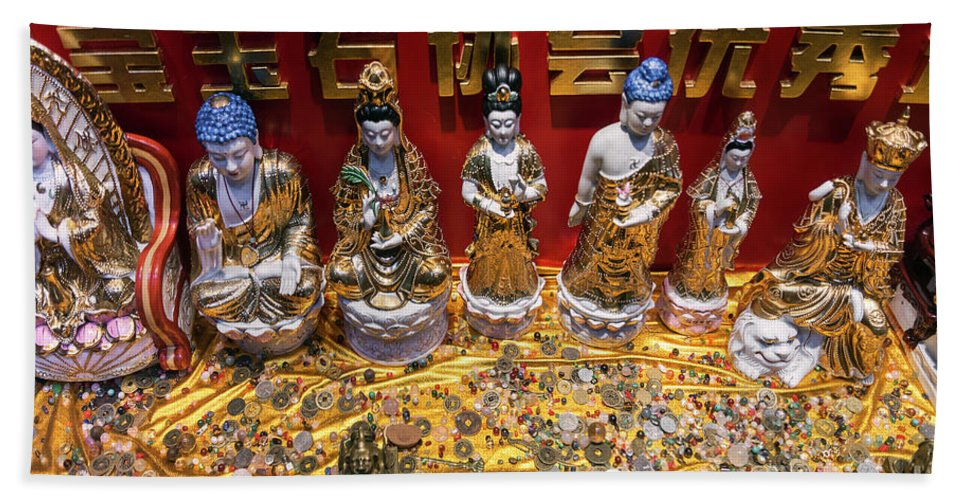 Amulets Hand Towel featuring the photograph Chinese Religious Trinkets And Statues On Display In Xiamen Chin by Jacek Malipan